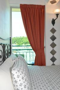 Un ou plusieurs lits dans un hébergement de l'établissement Bali Holiday Resort