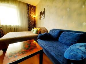 Гостиная зона в Apartments at Kosygina 17