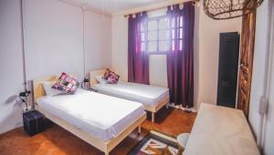 Ein Bett oder Betten in einem Zimmer der Unterkunft Selina Antigua
