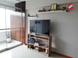 A television and/or entertainment centre at Colibrí