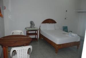 A bed or beds in a room at Hospedaje Papagrande