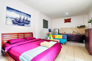 A bed or beds in a room at ABC Apartment Sanur