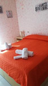 Letto o letti in una camera di Don Pasquale Scontrone House