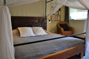Een bed of bedden in een kamer bij Africa House Malawi