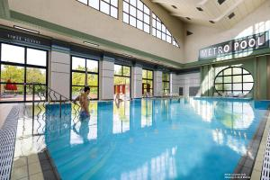 The swimming pool at or near Disney's Hotel New York® - The Art of Marvel
