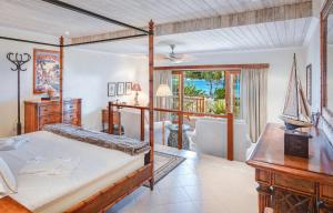 A bed or beds in a room at Bequia Beach Luxury Boutique Hotel