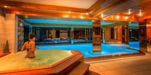 The swimming pool at or near Le Dahu Hotel-Chalet de Tradition