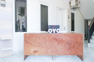 The lobby or reception area at OYO 1486 Tantular Residence