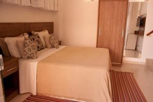 A bed or beds in a room at Hotel Vista Bella