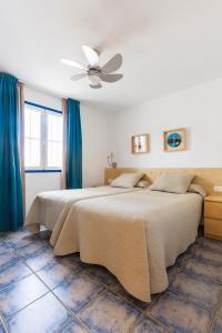 Een bed of bedden in een kamer bij Nautilus Lanzarote