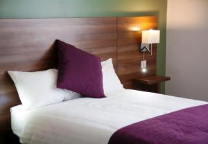 A bed or beds in a room at Yorkshire Gateway Hotel