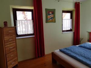 Ein Bett oder Betten in einem Zimmer der Unterkunft Ferienhaus Habitat Wonnegau