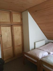 A bed or beds in a room at Horský Ranč