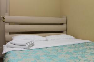 Кровать или кровати в номере Гостиница Улан