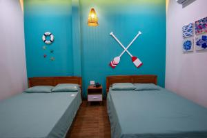 A bed or beds in a room at Sea House Cù Lao Xanh