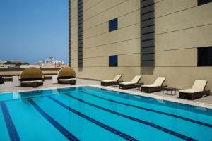 The swimming pool at or close to Adagio Aparthotel Jeddah Malik Road