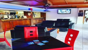 The lounge or bar area at Gilson Hotel