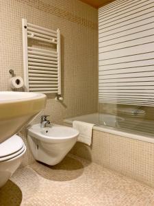 Um banheiro em Hotel Becher
