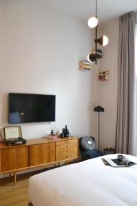 A bed or beds in a room at FINCH - boutique hotel