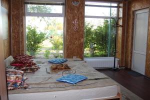 Кровать или кровати в номере База Дракон село Ниновка Икрянинский район Астраханская область 416353