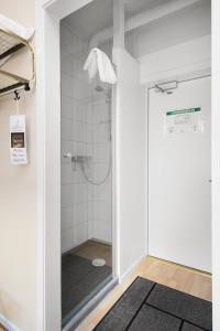 Ett badrum på Hotel Duxiana Kristianstad