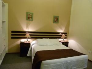 A bed or beds in a room at La Posada Del Fraile