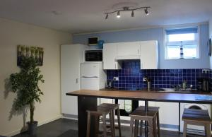 A kitchen or kitchenette at Beautiful Seaside Apartments