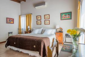 A bed or beds in a room at Hotel del Antiguo Convento