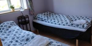 En eller flere senge i et værelse på Alrum Bed&Breakfast