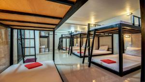 A bunk bed or bunk beds in a room at Siem Reap Pub Hostel