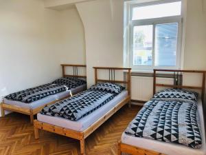 Posteľ alebo postele v izbe v ubytovaní Apartmány Dubická