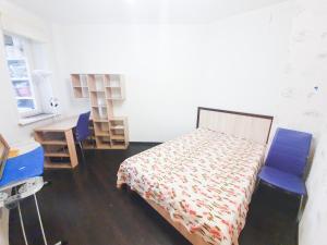 Кровать или кровати в номере Lux Apartaments Ильинский бульвар 7