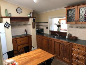 A kitchen or kitchenette at Greenock's Old Telegraph Station