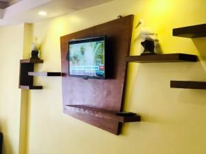 A television and/or entertainment center at Backyard Hotel