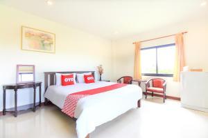 OYO 321 Country Place Hua Hinにあるベッド