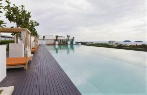The swimming pool at or close to Sutera Avenue Residence by Privilege Suites