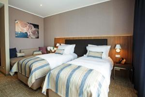Кровать или кровати в номере ЛетоЛето Термал Резорт & СПА
