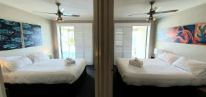 A bed or beds in a room at Scarborough Beach Front Resort - Shell Seven