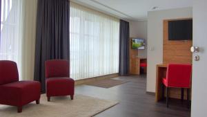 Ein Sitzbereich in der Unterkunft Hotel Kammerer