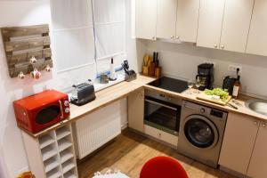 מטבח או מטבחון ב-Grand Accommodation Apartments