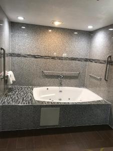 A bathroom at Super 8 by Wyndham Inglewood/LAX/LA Airport