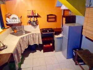 A kitchen or kitchenette at Live at the Beach & Surf Copacabana