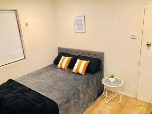 A bed or beds in a room at Studio 68 Bondi Beach