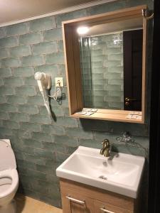 Ванная комната в Отель Грибоедов