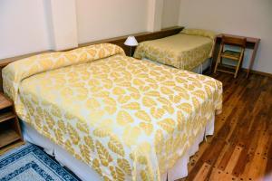 Кровать или кровати в номере Hotel Muelle Viejo