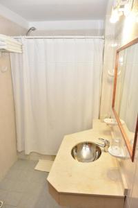 Ванная комната в Hotel Muelle Viejo