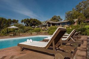 The swimming pool at or near Estalagem e Restaurante La Hacienda