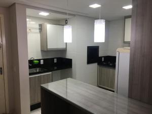 A cozinha ou cozinha compacta de Apartamento Super Aconchegante