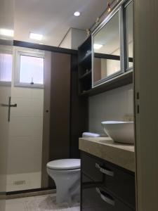 Um banheiro em Apartamento Super Aconchegante