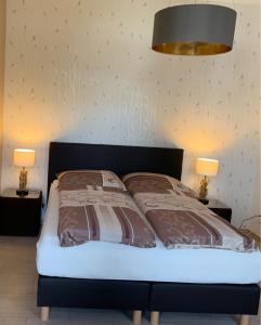 Ein Bett oder Betten in einem Zimmer der Unterkunft Pension Gerber